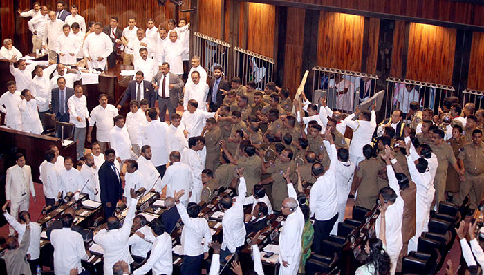 Sri Lanka police members protect Parliament Speaker Karu Jayasuriya in Parliament of Sri Lanka