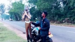 Pretending to give a bribe to a traffic Police cutout in Sri Lanka