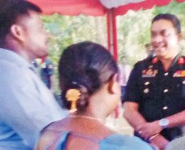 Jaffna Army Chief Major General Dharshana Hettiarachchi along with house recipient Randika Chaturanga and his wife.