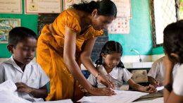 Sri Lankan teacher with children