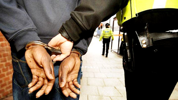 Handcuffed by the police