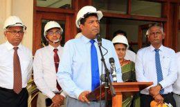 Ravi Karunanayake with electricity board officials in Sri Lanka