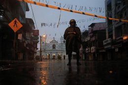 Soldier stands guard during heavy rain in Sri Lanka