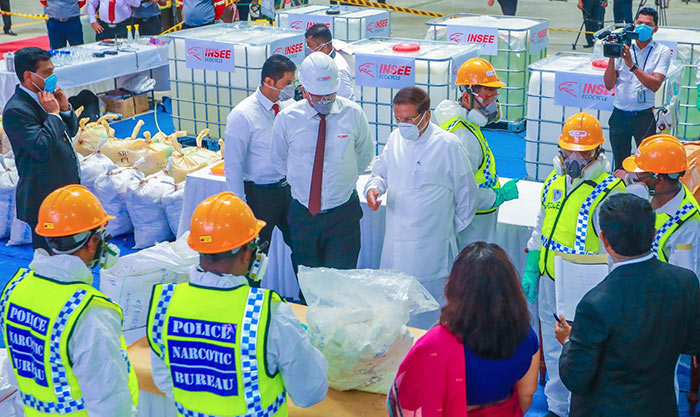 Sri Lanka President Maithripala Sirisena inspects hauls of cocaine which were to be destroyed