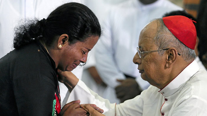 Relative of a victim of Easter bombings in Sri Lanka meets Cardinal Malcolm Ranjith