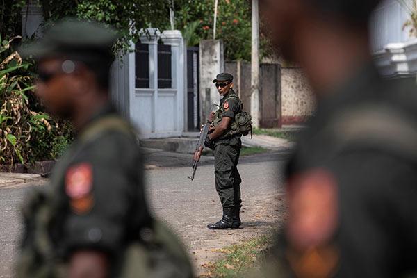 Sri Lanka soldiers stand guard