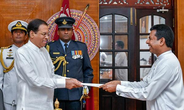 Sri Lanka President Maithripala Sirisena and Minister Buddhika Pathirana