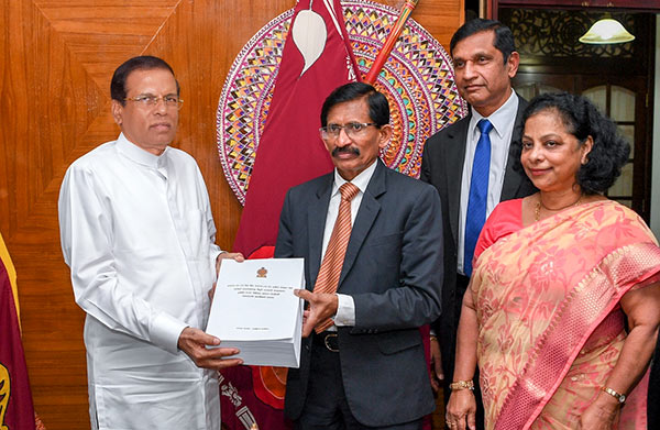 Presidential Commission on fraud & corruption hands over final report to Sri Lanka President Maithripala Sirisena