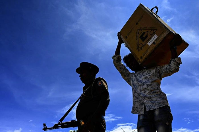 A man carrying a ballot box for election in Sri Lanka