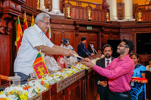 Sri Lanka President Gotabaya Rajapaksa handing over an Appointment letter to a graduate