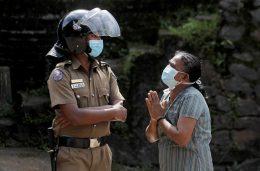 Sri Lanka Policeman stands near Mahara prison while clash in progress