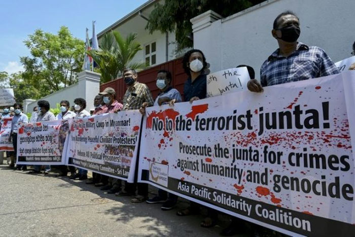 Activists protest outside Myanmar's embassy in Colombo Sri Lanka
