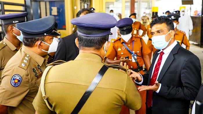 Nalin Bandara with policemen