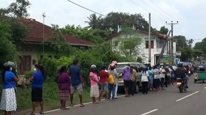 Long queues to buy essential goods in Sri Lanka